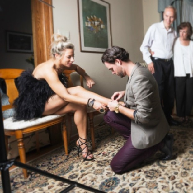 Travis helping me strap up some KILLER YSL's at our engagement party; I'd be nothing without him! Better Together Forever.